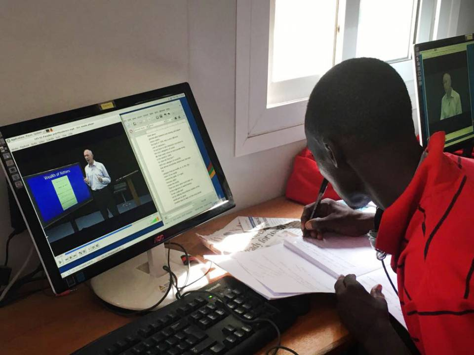 """Through a series of courses taught in conjunction with a worldwide network of partner institutions, Princeton's Global History Lab (GHL) aims to foster truly global conversations among learners hailing from diverse backgrounds. Pictured: A student in the InZone Learning Hub located in Kakuma Refugee Camp in Kenya participates in the open-access, online course """"A History of the World,"""" also offered as an undergraduate history course at Princeton, taught by GHL founder Jeremy Adelman, the Henry Charles Lea Pr"""