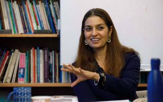 "Jhumpa Lahiri, director of Princeton University's Program in Creative Writing, leads her spring 2020 course, ""Advanced Fiction: Imitating Italians,"" prior to the COVID-19 pandemic. The course relied heavily on translated texts and considered the limitations of translation. Photo by Denise Applewhite, Office of Communications"