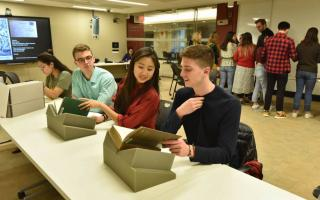 Undergraduate students (from left) Keely Toledo, Joseph DiMarino, Jimin Kang and Alexander Krauel study materials in the Princeton University Library Special Collections before the start of remote instruction due to the COVID-19 pandemic. Photo byMark Czajkowski
