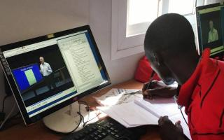 "Through a series of courses taught in conjunction with a worldwide network of partner institutions, Princeton's Global History Lab (GHL) aims to foster truly global conversations among learners hailing from diverse backgrounds. Pictured: A student in the InZone Learning Hub located in Kakuma Refugee Camp in Kenya participates in the open-access, online course ""A History of the World,"" also offered as an undergraduate history course at Princeton, taught by GHL founder Jeremy Adelman, the Henry Charles Lea Pr"